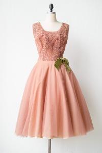 http://www.adoredvintage.com/images/dresses/vintage1950spinksequinedtullepartydress.jpg