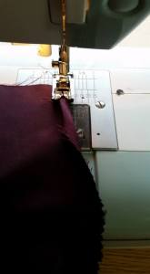 Making a simple rolled hem for the bottom of the sleeve insert.