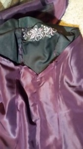 Inside of the dress, at center front.