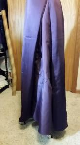 Extra lining fabric sewn into side skirt seams.  No petticoat.