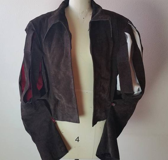jacket shown with red undersleeve, and white shirt sleeve