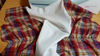 insert puffing out of sleeve, before elastic cut