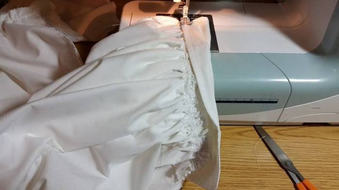 Folding the cuff in 1/2 to enclose the seam allowance and form a casing for the elasic
