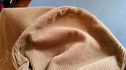 raising the sleeve, and shortening the shoulder seam