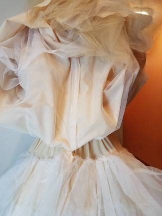 top fully lined with petticoat net; very full underskirt