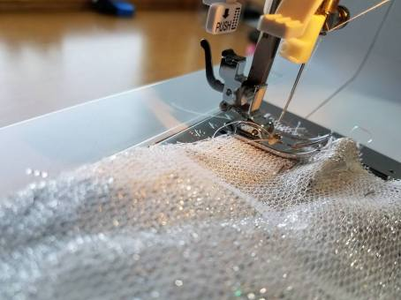 basting the petticoat net to the fashion fabric
