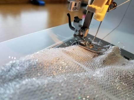 basting the petticoat net to the fashion fabric