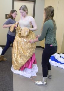 gold dress over pink top and skirt