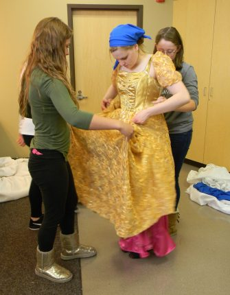 bringing gold skirt up to waist and wrapping tightly, Cinderella