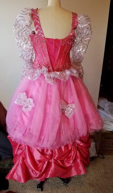 back of dress, pulled up skirt