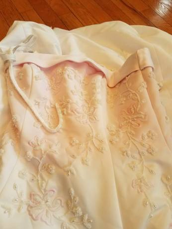 the lining showing through the white satin