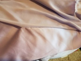 The chiffon layer is sewn partially in to the seam