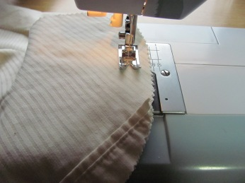 stitch around the sides, WRONG sides together