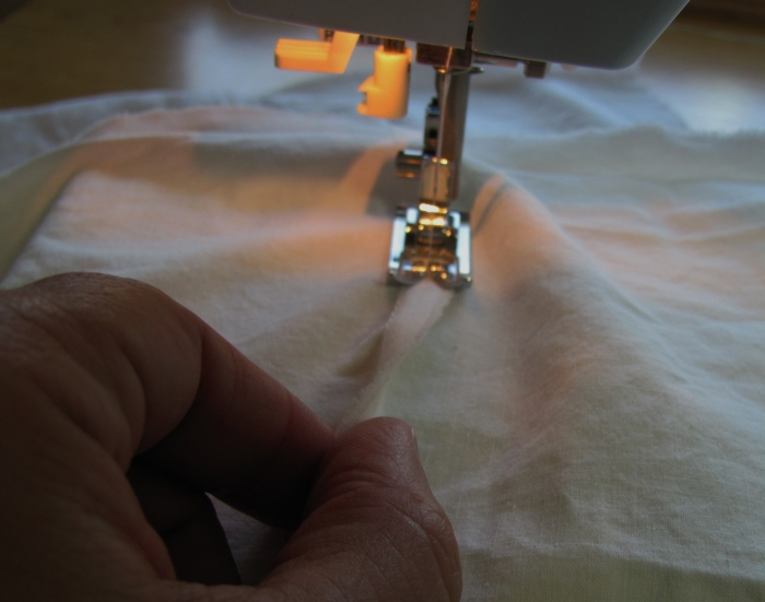 finish the seams--here I am stitching them down.
