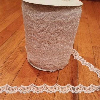 400 yards of white scalloped lace