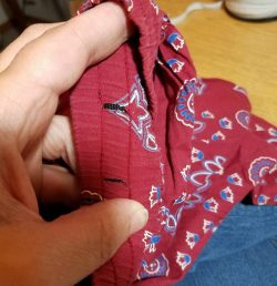 cutting two holes for drawstring