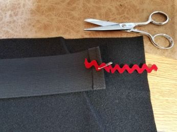 pinning on a scrap so the elastic can be pulled