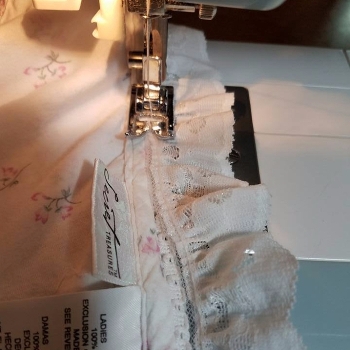 stitching lace on to the neckline
