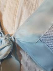 ribbon stitched to sweater
