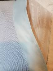 ribbon topstiched to sweater