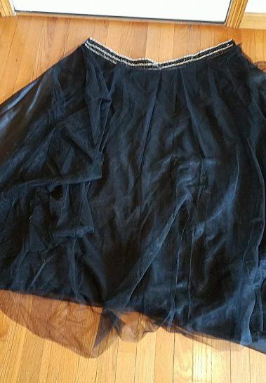 layered overskirt with rhinestone waistbang