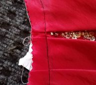 basting to mark stitching line, keep the pleats in place, and to help avoid the beads