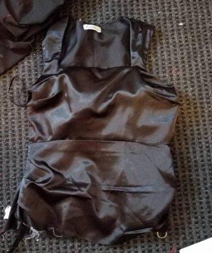 bottom of dress cut off below level of side zipper