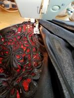 stitching the front motif in place