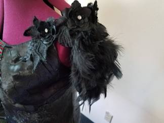 black lace applique and pieces of the feather boa