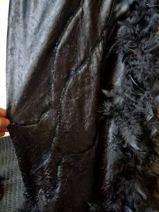 black sequins appliqued in a swirl design