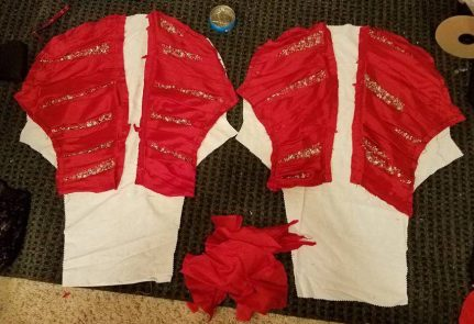 laying out the appliques on the sleeve lining