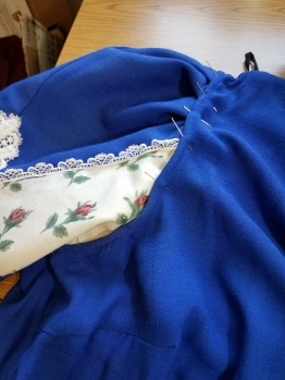 inserting sleeve--tucks pinned in
