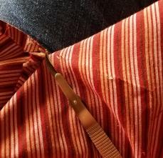 using a seam ripper to remove the pocket