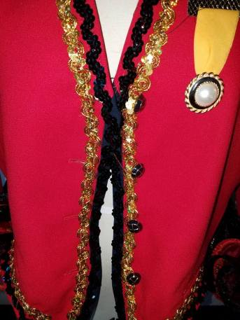 """front detail, button """"medals"""""""