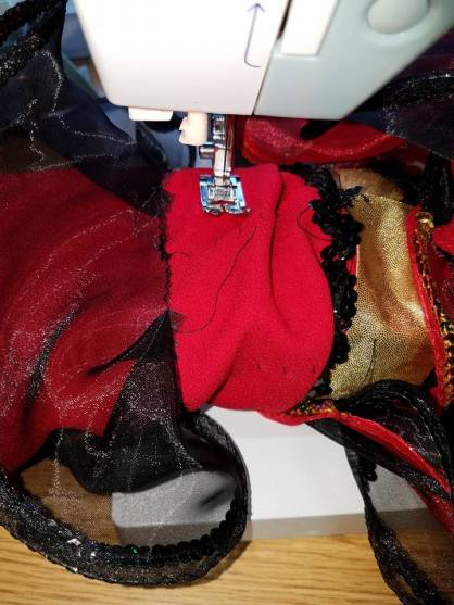 """sewing on the prepped """"donuts"""" of organza"""""""