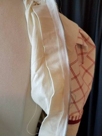 extra fabric in back, easy alterations by moving zipper
