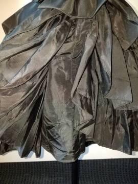 back of skirt, ruffles raise at center back