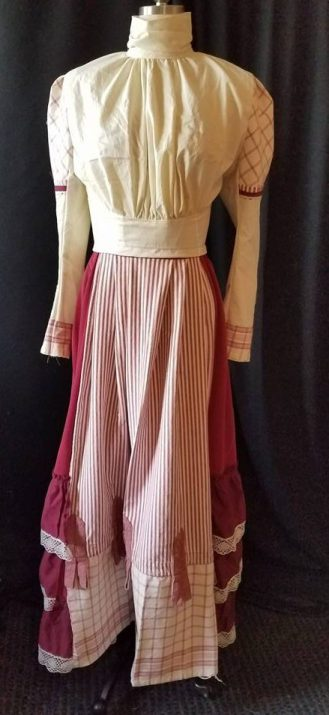 front of burgundy Fun Fair costume