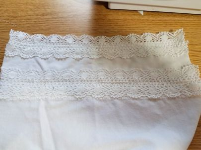 sleeves trimmed with lace