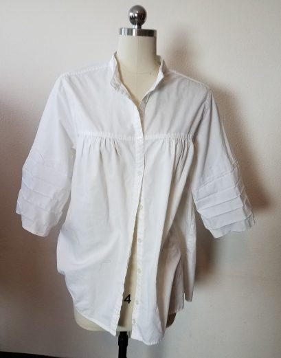 blouse with collar removed and sleeves uncuffed