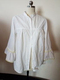 blouse with collar restitched and ruffles on sleeves
