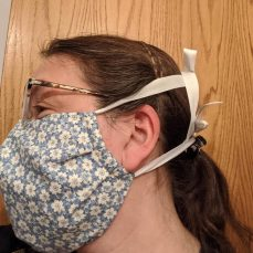 Side, over mask, ties can go to top of head